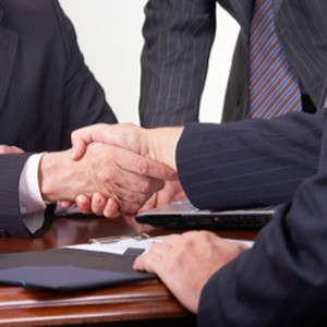 Close up shot of two businessmen shaking hands